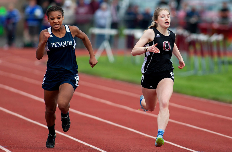 DOVER-FOXCROFT, Maine -- 06/03/2017 - Penquis' Camera Robshaw (left) and Orono's Katherine O'Brien compete in the 100 meter dash as part of the State Class C Track and Field Championship Meet at Foxcroft Academy in Dover-Foxcroft Saturday. O'Brien took first while Robshaw took second. Ashley L. Conti | BDN