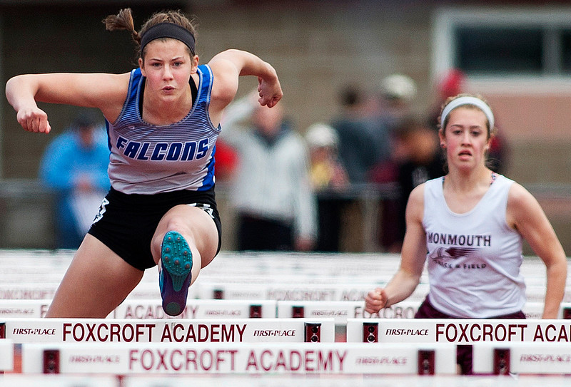 DOVER-FOXCROFT, Maine -- 06/03/2017 - Mountain Valley's Lauren Sterling (left) takes the lead during the 100 meter hurdles as part of the State Class C Track and Field Championship Meet at Foxcroft Academy in Dover-Foxcroft Saturday. Sterling placed first in the event. Ashley L. Conti | BDN