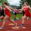 DOVER-FOXCROFT, Maine -- 06/03/2017 - Orono and Dexter teams pass of the baton during the 4x100 meter relay as part of the State Class C Track and Field Championship Meet at Foxcroft Academy in Dover-Foxcroft Saturday.  Ashley L. Conti | BDN
