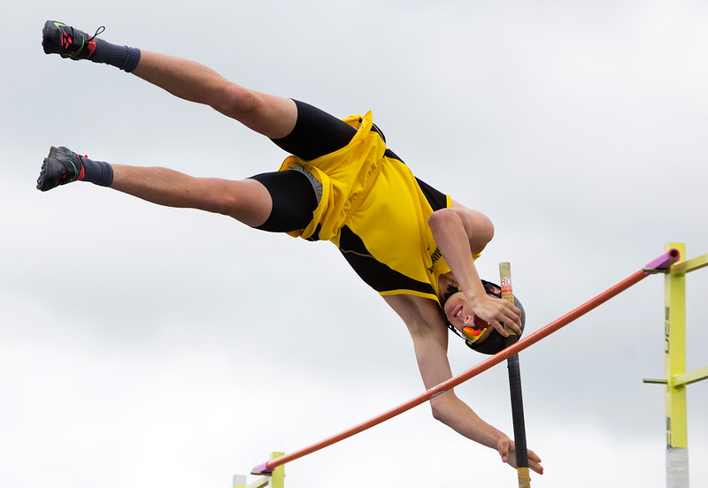 DOVER-FOXCROFT, Maine -- 06/03/2017 - Maranacook's William Green clears the bar while pole vaulting during the State Class C Track and Field Championship Meet at Foxcroft Academy in Dover-Foxcroft Saturday. Green placed first in the event. Ashley L. Conti | BDN
