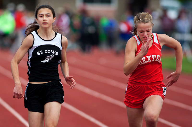 DOVER-FOXCROFT, Maine -- 06/03/2017 - St. Dominic's Alexandra Hammerton (left) and Dexter's Danielle Cummings compete in the 100 meter dash as part of the State Class C Track and Field Championship Meet at Foxcroft Academy in Dover-Foxcroft Saturday.  Ashley L. Conti | BDN