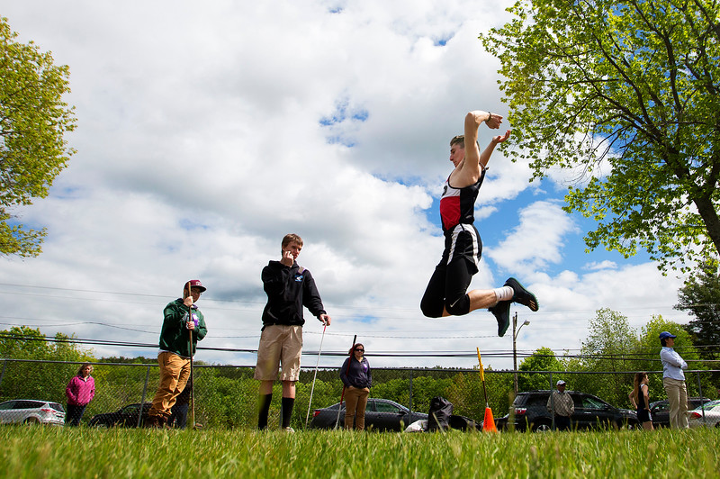 DOVER-FOXCROFT, Maine -- 06/03/2017 - Hall-Dale's Alec Roberts-Poulin competes in the triple jump during the State Class C Track and Field Championship Meet at Foxcroft Academy in Dover-Foxcroft Saturday.  Ashley L. Conti | BDN