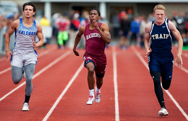 DOVER-FOXCROFT, Maine -- 06/03/2017 - Mount Valley's Elijah Turner (from left), Washington Academy's Michaiah Robinson, and Traip Academy's Evan Porter compete in the 100 meter dash as part of the State Class C Track and Field Championship Meet at Foxcroft Academy in Dover-Foxcroft Saturday. Porter took first, Robinson second, and Turner fourth. Ashley L. Conti | BDN