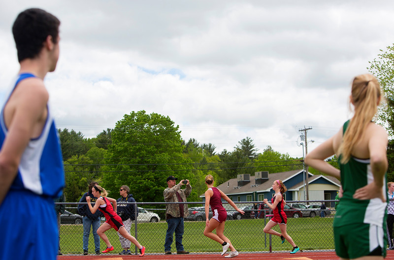 DOVER-FOXCROFT, Maine -- 06/03/2017 - Runners make the handoff during the 4x100 meter relay during the State Class C Track and Field Championship Meet at Foxcroft Academy in Dover-Foxcroft Saturday.  Ashley L. Conti   BDN