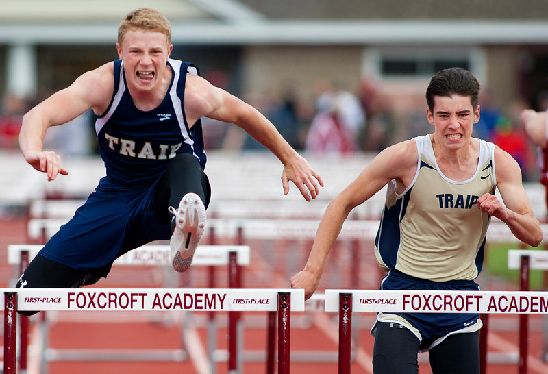 DOVER-FOXCROFT, Maine -- 06/03/2017 - Traip Acadmey's Evan Porter (left) and Traip Academy's Samuel Simonds compete in the 110 meter hurdles as part of the State Class C Track and Field Championship Meet at Foxcroft Academy in Dover-Foxcroft Saturday. Porter took first and Simonds third. Ashley L. Conti | BDN