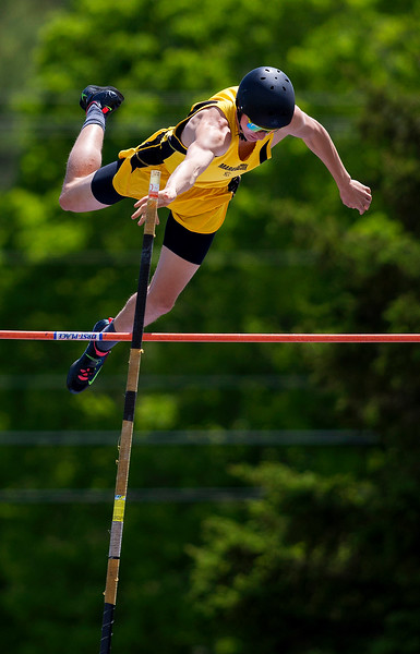 DOVER-FOXCROFT, Maine -- 06/03/2017 - Maranacook's William Green clears the bar while pole vaulting during the State Class C Track and Field Championship Meet at Foxcroft Academy in Dover-Foxcroft Saturday. Green placed first in the event. Ashley L. Conti   BDN