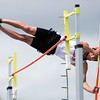 DOVER-FOXCROFT, Maine -- 06/03/2017 - Lisbon's Kurtis Bolton clears the bar during the pole vault during the State Class C Track and Field Championship Meet at Foxcroft Academy in Dover-Foxcroft Saturday.  Ashley L. Conti | BDN