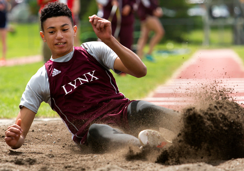 DOVER-FOXCROFT, Maine -- 06/03/2017 - Mattanawcook Academy's Cayden Spencer-Thompson lands in the dirt after competing in the triple jump during the State Class C Track and Field Championship Meet at Foxcroft Academy in Dover-Foxcroft Saturday. Spencer-Thompson placed first in the event and set a new state record. Ashley L. Conti | BDN