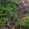 ORRINGTON, Maine -- 07/01/2017 - Racers make their way up a steep hill during the inaugural Wicked Muddy Mainer obstacle course race at the Thornton Family Campground in Orrington Saturday. More than 700 racers made their way through four miles filled with mud, hills, water, and 14 obstacles.  Ashley L. Conti | BDN