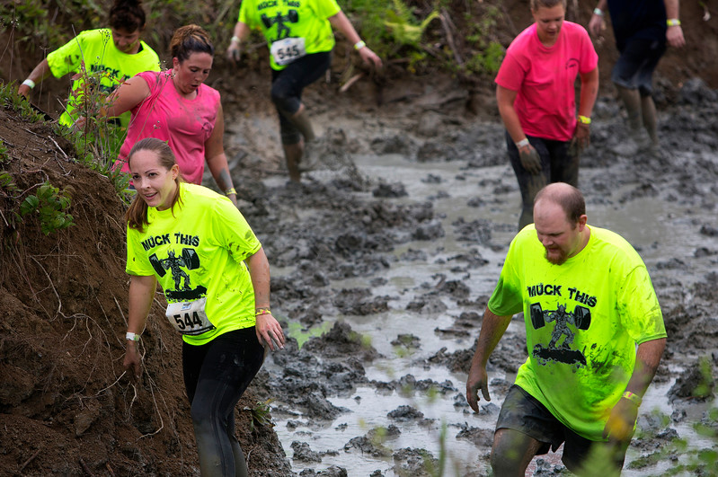 ORRINGTON, Maine -- 07/01/2017 - during the inaugural Wicked Muddy Mainer obstacle course race at the Thornton Family Campground in Orrington Saturday. More than 700 racers made their way through four miles filled with mud, hills, water, and 14 obstacles.  Ashley L. Conti | BDN