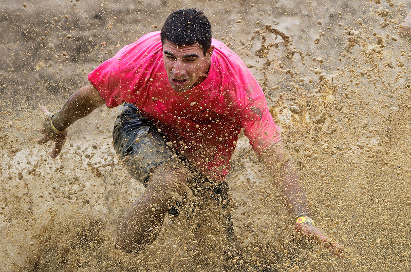 ORRINGTON, Maine -- 07/01/2017 - Mike Comstock runs through a mud filled trail while competing in the inaugural Wicked Muddy Mainer obstacle course race at the Thornton Family Campground in Orrington Saturday. More than 700 racers made their way through four miles filled with mud, hills, water, and 14 obstacles.  Ashley L. Conti   BDN