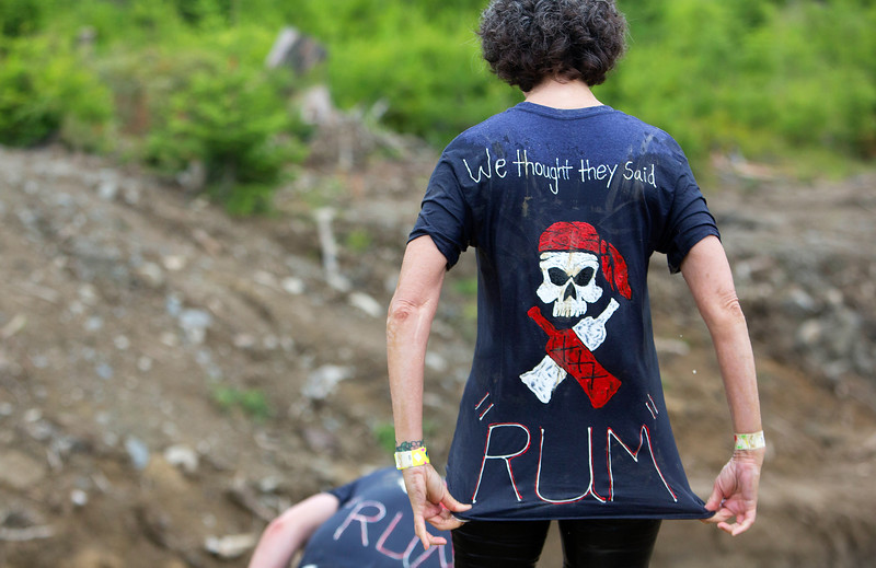 ORRINGTON, Maine -- 07/01/2017 - A racer takes a moment before going into a mud pit during the inaugural Wicked Muddy Mainer obstacle course race at the Thornton Family Campground in Orrington Saturday. More than 700 racers made their way through four miles filled with mud, hills, water, and 14 obstacles.  Ashley L. Conti | BDN
