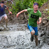ORRINGTON, Maine -- 07/01/2017 - A racer runs through the mud during the inaugural Wicked Muddy Mainer obstacle course race at the Thornton Family Campground in Orrington Saturday. More than 700 racers made their way through four miles filled with mud, hills, water, and 14 obstacles.  Ashley L. Conti | BDN