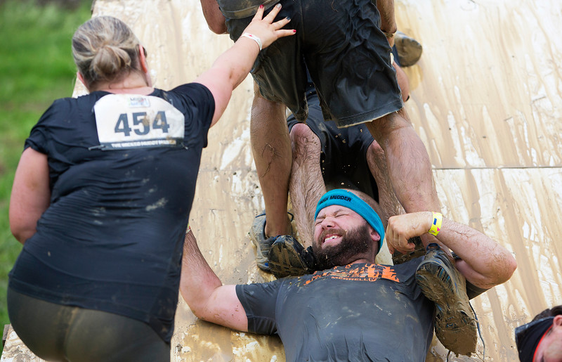 ORRINGTON, Maine -- 07/01/2017 - Racers help each other over an obstacle during the inaugural Wicked Muddy Mainer obstacle course race at the Thornton Family Campground in Orrington Saturday. More than 700 racers made their way through four miles filled with mud, hills, water, and 14 obstacles.  Ashley L. Conti | BDN