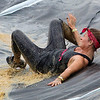 ORRINGTON, Maine -- 07/01/2017 - A racer make her way down a slide during the inaugural Wicked Muddy Mainer obstacle course race at the Thornton Family Campground in Orrington Saturday. More than 700 racers made their way through four miles filled with mud, hills, water, and 14 obstacles.  Ashley L. Conti | BDN