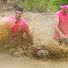 ORRINGTON, Maine -- 07/01/2017 - Mike Comstock (left) and Charles Harding splash muddy water while competing in the inaugural Wicked Muddy Mainer obstacle course race at the Thornton Family Campground in Orrington Saturday. More than 700 racers made their way through four miles filled with mud, hills, water, and 14 obstacles.  Ashley L. Conti | BDN