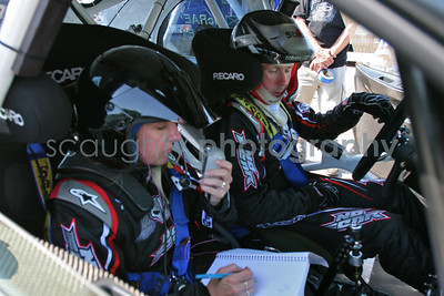 Driver Colin McRae* and co-driver Carolyn Bosley, carefully recalculate and adjust their calculations after a few runs through the street section of the rally course. McRae and Bosley, while driving a black Subaru WRX STI, went on to place fifth in the Rally Car Racing Super Special.    *Colin McRae was later killed in a helicopter crash on September 9th, 2007.