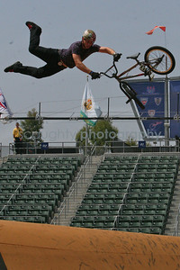 This BMX park competitor superman double tail whips over one of the many gaps.