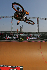 This Vert rider tweaks a huge air while warming up for the BMX Vert Finals Event.