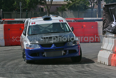 A Mitsubishi EVO VIII drifts around a corner during the Rally Car practice session.