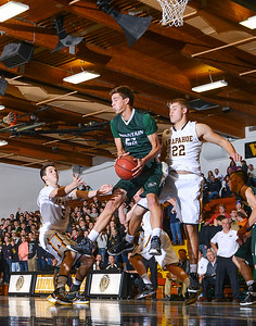Mountain Vista's Graham Smith (25) grads a rebound in the 63-55 losss to Arapahoe.