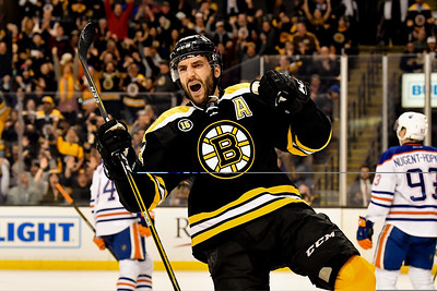 Boston Bruins center Patrice Bergeron (37) celebrates his second period goal during a NHL hockey game.