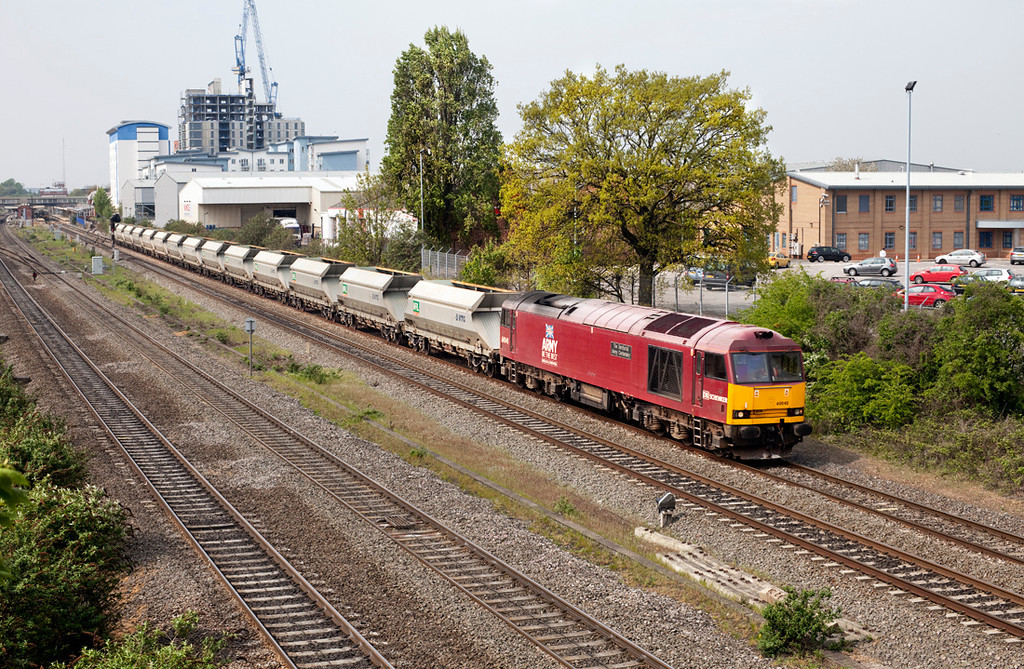 In dull April sunshine 60040 passes Slough with the 6A79 12.52 Theale-Acton Yard empty stone working.18.4.11