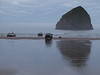 Haystack Rock & fishermen launching dory boats at Cape Kiwanda