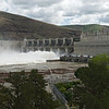 Spillways full of high flows at Lower Granite Dam.  Note debris in backwater