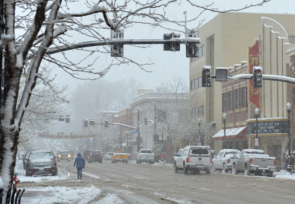 Justin Sheely | The Sheridan Press<br /> Traffic lights are down during a power outage Tuesday morning along Sheridan's Main Street. Much of downtown Sheridan was without power for about an hour during Tuesday's spring snow. Many parts of the county experienced outages throughout the day.