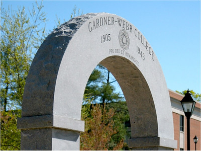 J.D. Huggins Memorial Arch: One of the most signature features on campus, the Huggins Memorial Arch, originally commemorated in 1943 to honor the service of Professor J.D. Huggins, now stands outside the LYCC.  A gateway symbol of the transient moment between past and future, the Arch stands as a reminder to us all that while our time here is special, and while we have been shaped by our relationships with each other and our experiences in this place, we are always being propelled into the future with a responsibility to serve and impact others.  In that spirit, graduates process through the Archway on their way to commencement, a fitting end to their journeys at Gardner-Webb and a beginning to their futures.