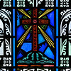 "Baptistry window. This window with the cross at the center represents the words of St. Paul from Romans 6:3: ""Are you unaware that we who were baptized into Christ Jesus were baptized into his death""."