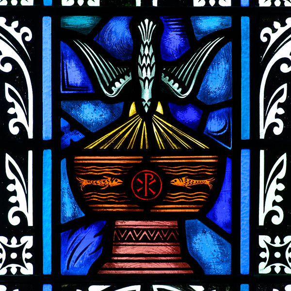 """Baptistry Window. The spirit coming down upon a chalice marked with the XP or chi rho. This symbolizes the passage in Luke 3:15: """"He will baptize you with the Holy Spirit and fire."""""""