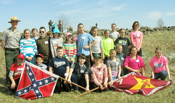 Students from St. Francis Academy in Bally recently visited Gettysburg battlefield and retraced the steps of the 28th Virginia Regiment during Pickett's charge. The students pose with Ranger Rosiecki at the conclusion of the 'charge'.