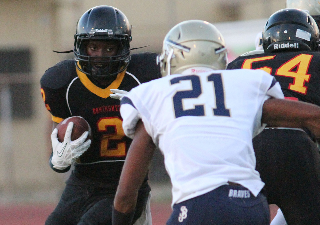 . August 30, 2013. Dominguez\'s Joshua Ford (2), left, looks to get by St. John Bosco\'s Chandler Hawkins (21), center, during Friday nights game at Dominguez High School in Compton, California. (Mark Dustin/For the Long Beach Press-Telegram)