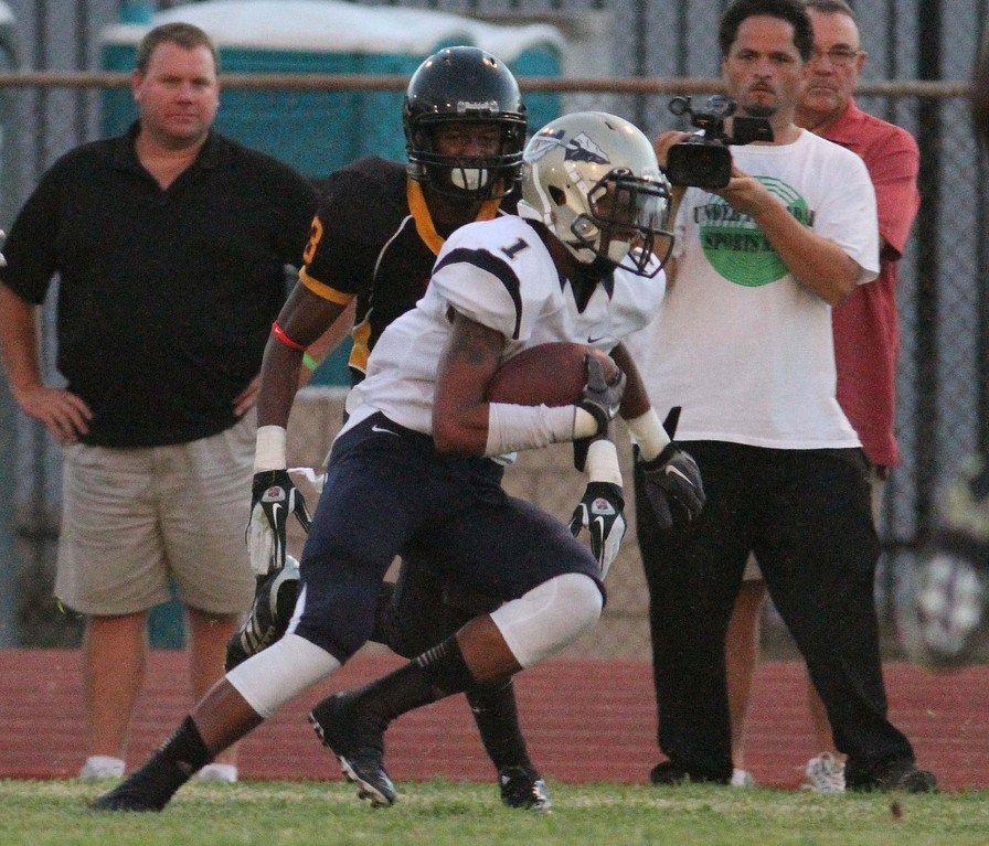 . August 30, 2013. St. John Bosco\'s Shay Fields (1), right, gets by Dominguez\'s Brandon Austin (3), left, along the sideline during Friday nights game at Dominguez High School in Compton, California. (Mark Dustin/For the Long Beach Press-Telegram)