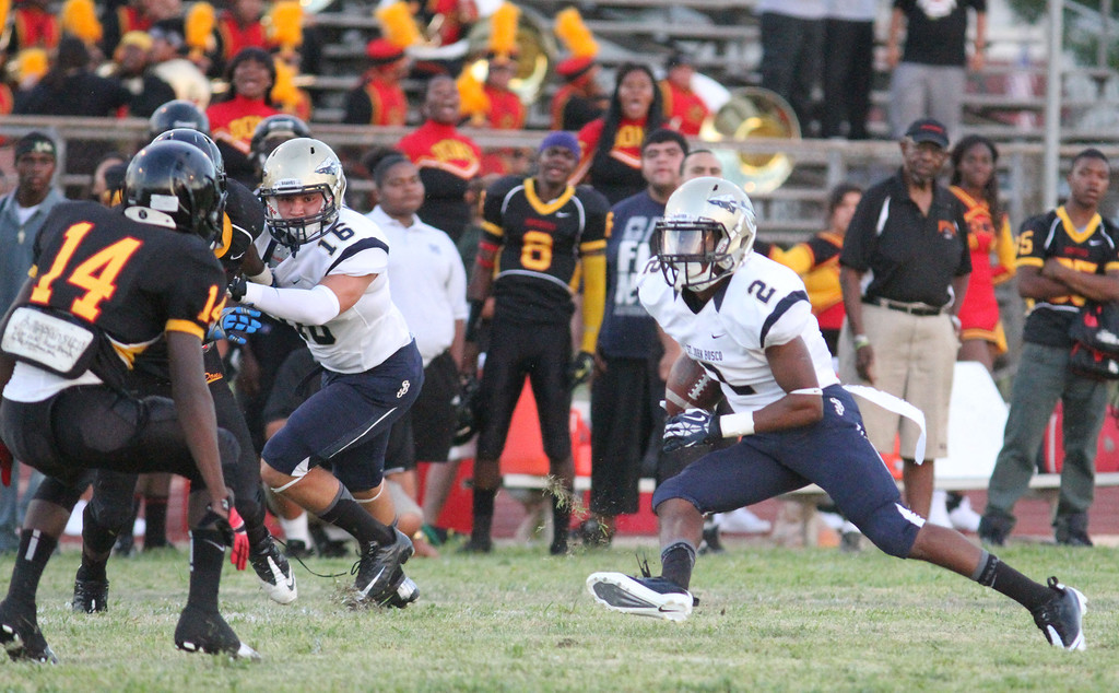 . August 30, 2013. St. John Bosco\'s Jaleel Wadood (2), right, heads up field behind the block of teammate Angelo Quintero (16), center, after catching a pass during Friday\'s game against Dominguez at Dominguez High School in Compton, California. (Mark Dustin/For the Long Beach Press-Telegram)