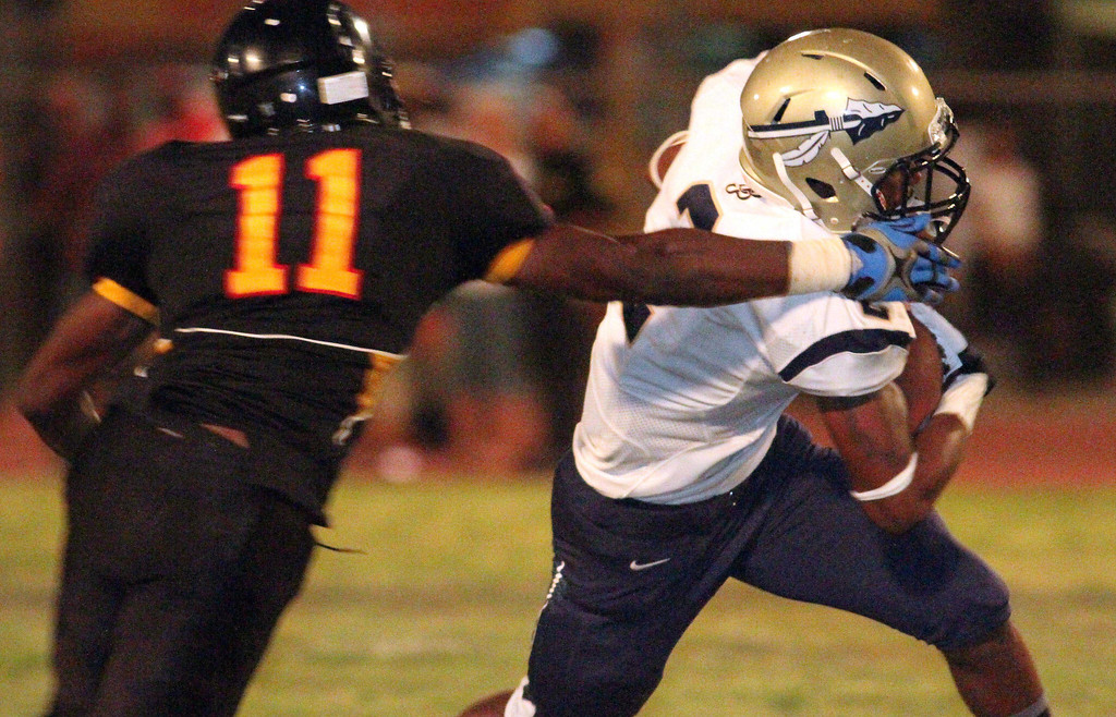 . August 30, 2013. St. John Bosco\'s Jaleel Wadood (2), right, tries to get by Dominguez\'s Domonique Lee (11), left, during Friday\'s game against Dominguez at Dominguez High School in Compton, California. (Mark Dustin/For the Long Beach Press-Telegram)