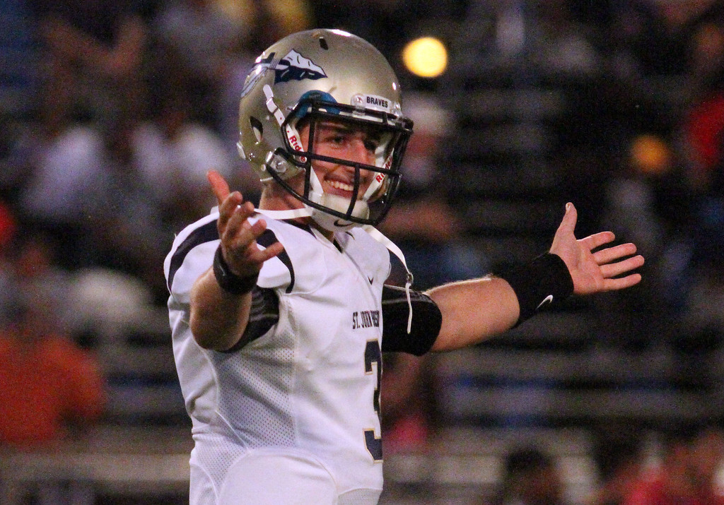 . August 30, 2013. St. John Bosco\'s Josh Rosen (3) smiles and looks to his teammates on the sideline after completing a pass for a touchdown during Friday\'s game against Dominguez at Dominguez High School in Compton, California. (Mark Dustin/For the Long Beach Press-Telegram)