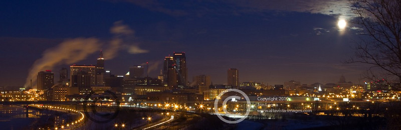 Panorama of downtown St. Paul with the full moon setting.