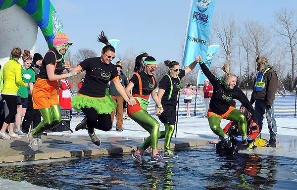 Pat Christman<br /> Jumpers hit the icy water during Saturday's Polar Plunge.