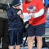 Pat Christman<br /> A Special Olympian reads a message before Saturday's Polar Plunge.
