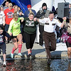 Pat Christman<br /> Law enforcement representatives, including Nicollet County Sheriff Dave Lange (in white shirt) jump during the Polar Plunge Saturday.