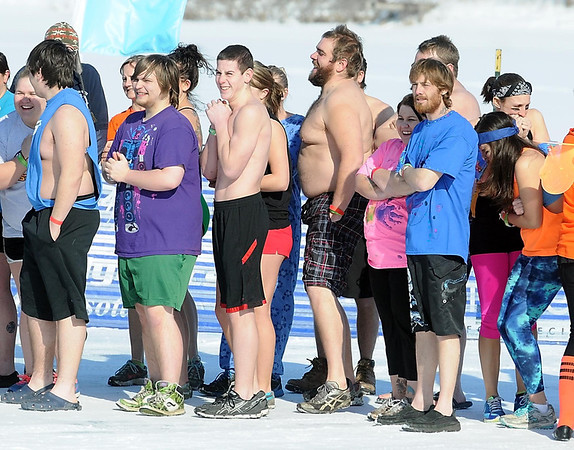 Pat Christman<br /> Jumpers shiver as they wait in line to take the plunge Saturday.