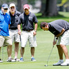 Nathan McBride from Connecticut Electric putts on the ninth green as from left, Fox 59's Bob Donaldson, Kevin Atkinson and Scott Temple look on during the Children's Clinic Classic at the Anderson Country Club on Tuesday.