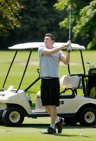 Rotnei Clarke watches his shot into the 11th green during the St. Vincent Anderson Regional Hospital Foundation Children's Clinic Golf Classic at the Anderson Country Club on Tuesday.