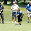 St.Vincent Anderson Regional Hospital Foundation Director Nancy Anderson checks the break on her putt as from left, John Mahaffey, Bob Kravitz and Frank Amos look on during the St. Vincent Anderson Regional Hospital Foundation Children's Clinic Golf Classic at the Anderson Country Club on Tuesday.