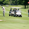 Darnell Hillman chips onto the 18th green as he plays with from left, Daniel Sizelove, Tony Smith, Jordan Kinley and Mike Tippey during the St. Vincent Anderson Regional Hospital Foundation Children's Clinic Golf Classic at the Anderson Country Club on Tuesday.