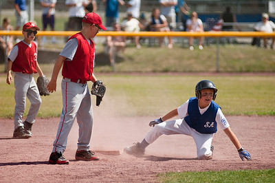 Saratoga American LL All Star Garrett Willard slides into second base at the East Side Rec in Saratoga during the game against Scotia Sunday afternoon. Photo Eric Jenks 7/8/12