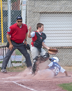 Scotia All Star Addison Schaub watches while Saratoga Ammerican LL All Str Christian Kondo slides into home plate at the East Side Rec in Saratoga during the game Sunday afternoon. Photo Eric Jenks 7/8/12
